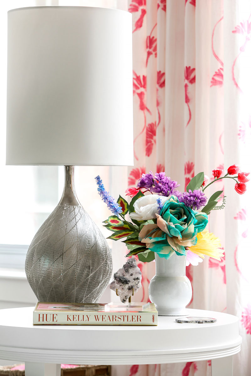 00 Elegtant modern drapes with silver lamp and fresh flowers