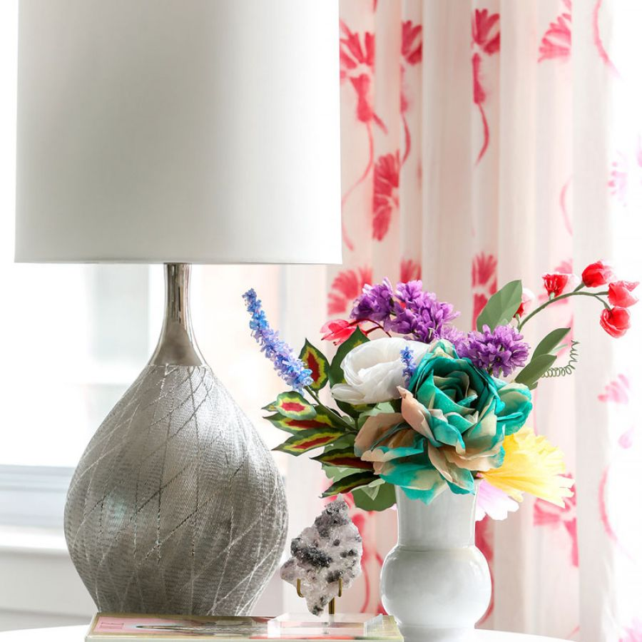 -Elegtant-modern-drapes-with-silver-lamp-and-fresh-flowers