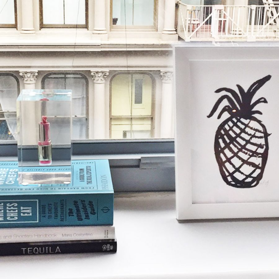 -framed-art-with-books-and-lucite-lipstick-house-candy