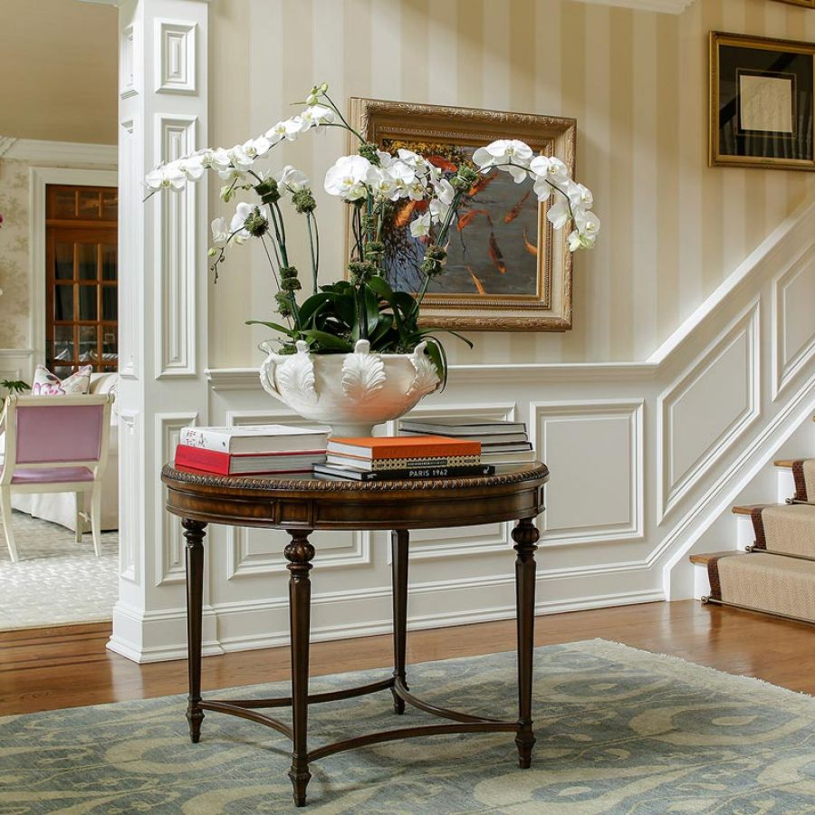 -foyer-table-books-orchid-frames-area-rug