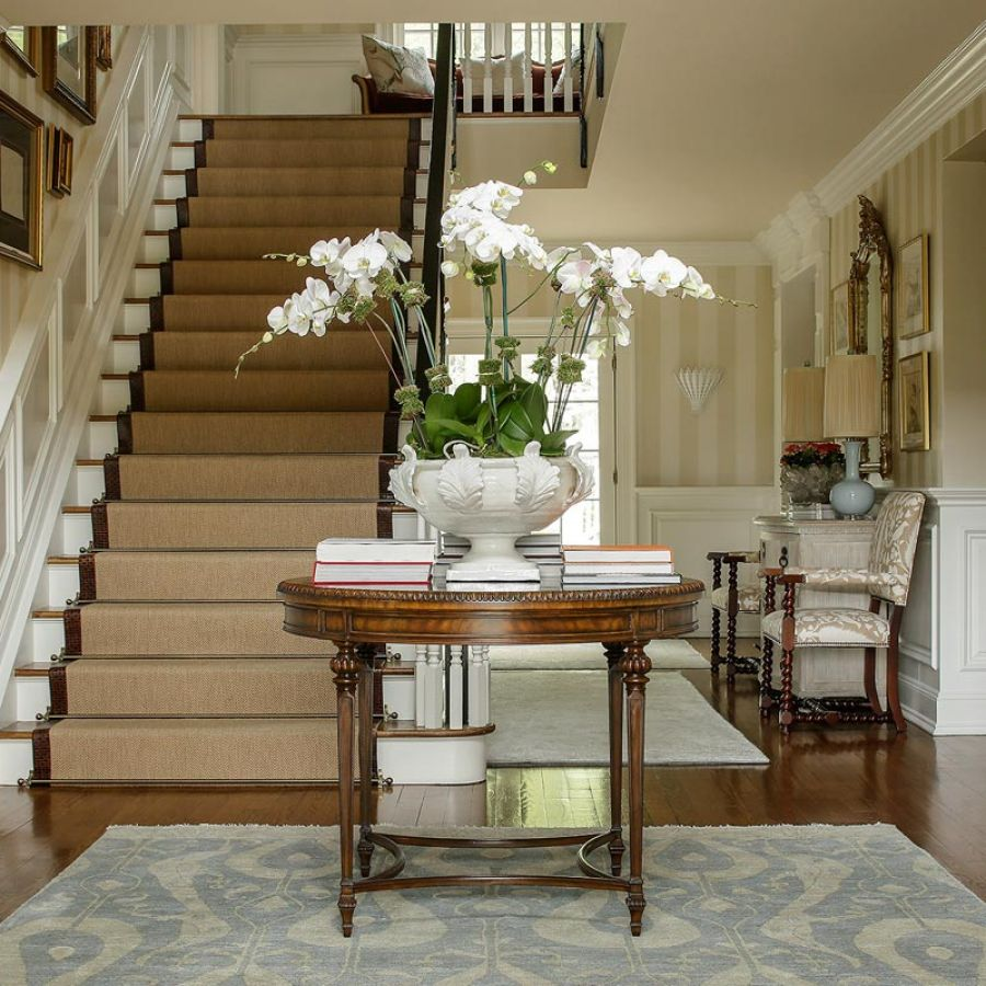 -entrance-foyer-table-orchid-stairs-framed-art-chairs