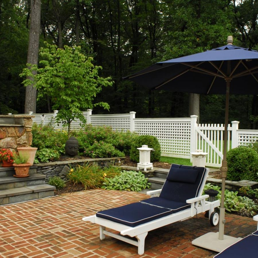 -backyard-outdoor-patio-umbrella-lounge-chairs-landscape