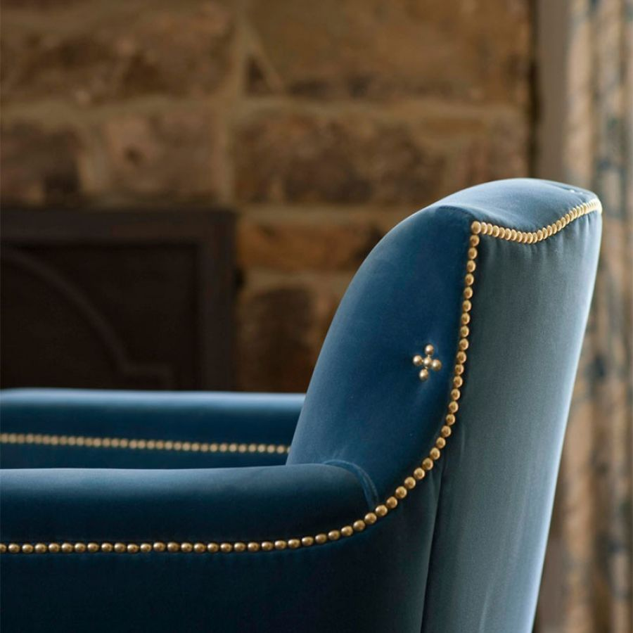 chair-detail-close-up-velvet-brass-nail-head-finish