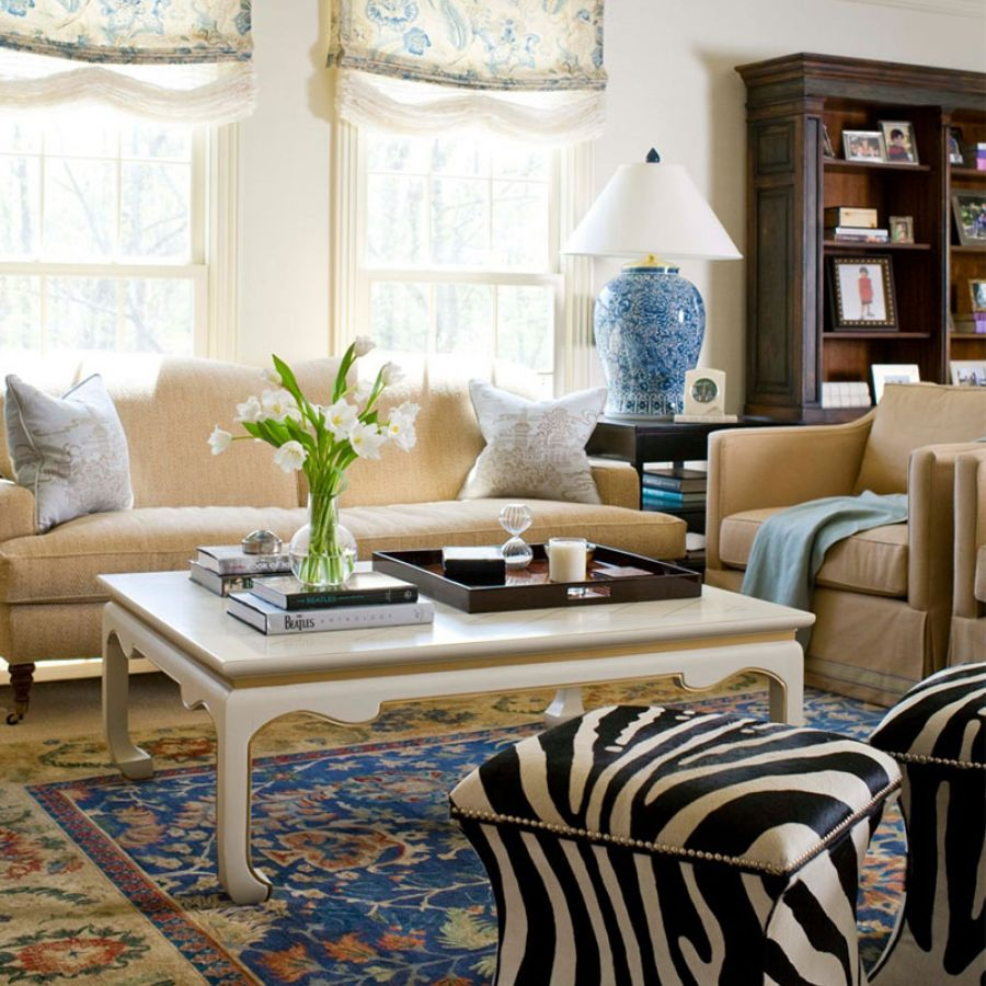 transitional-elegance-living-room-couches-flowers-books-table